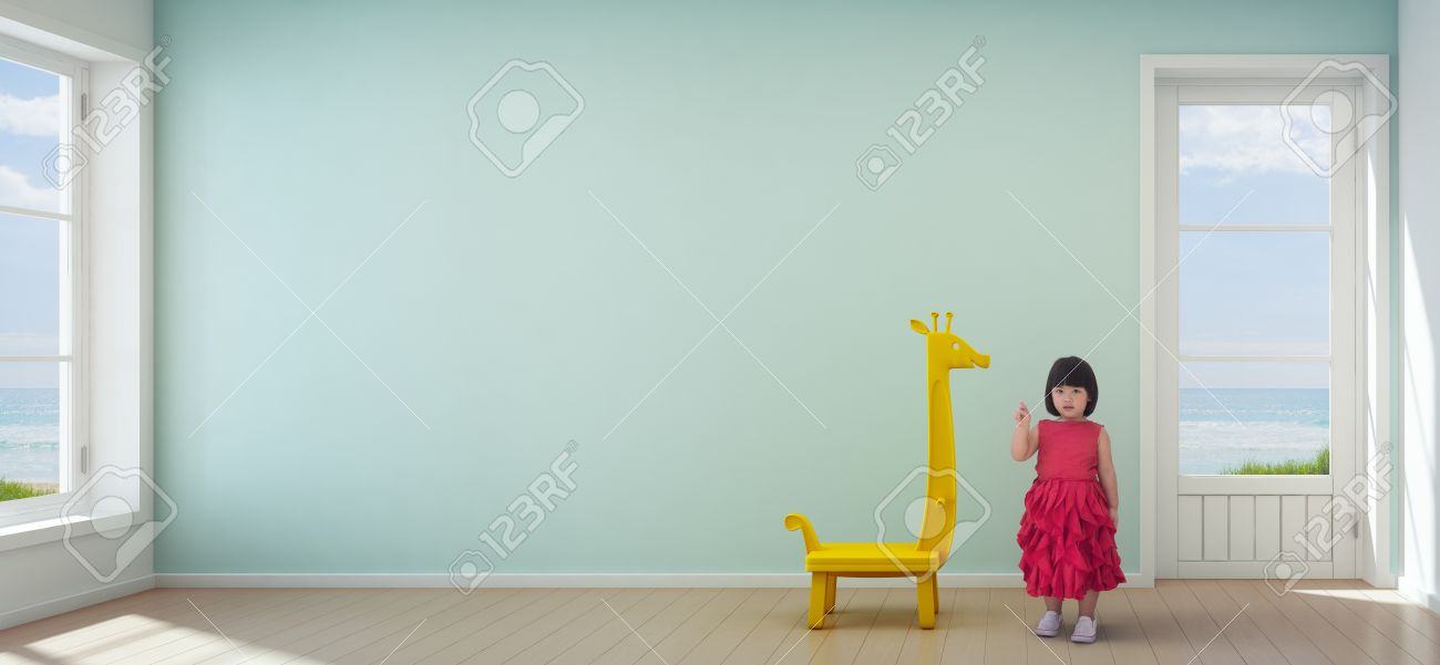 Asian Child Girl In Kids Room Of Modern Beach House With Empty Turquoise Wall Background