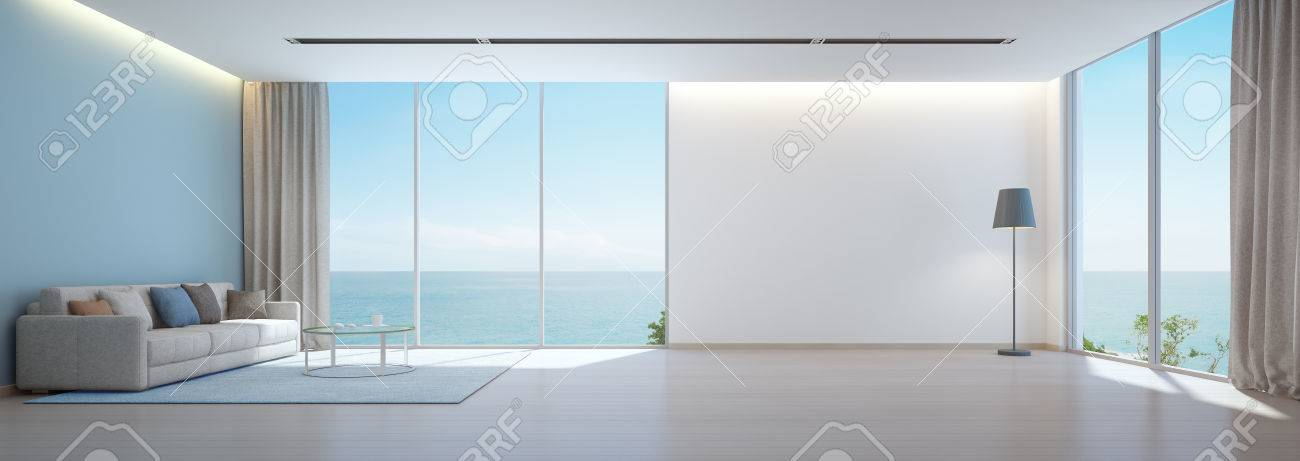 Sea View Living Room With Wooden Floor And Empty White Wall