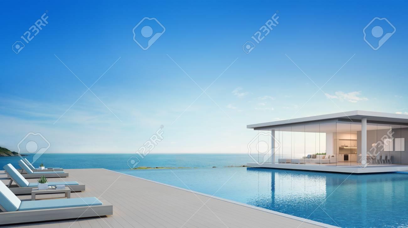 Casa De Playa De Lujo Con Piscina Y Terraza Con Vistas Al Mar En Un Diseño Moderno Sillones En El Piso De Madera En La Casa De Vacaciones O En El