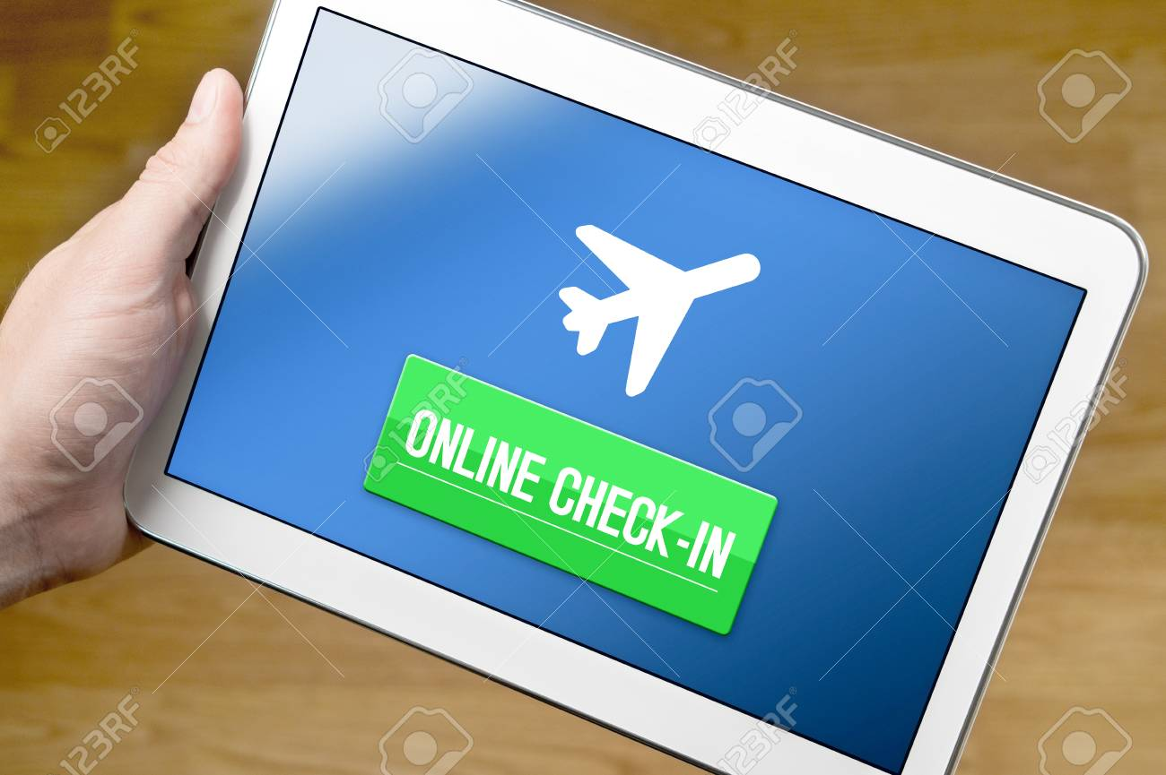 Man checking in to flight with tablet on the internet  Online