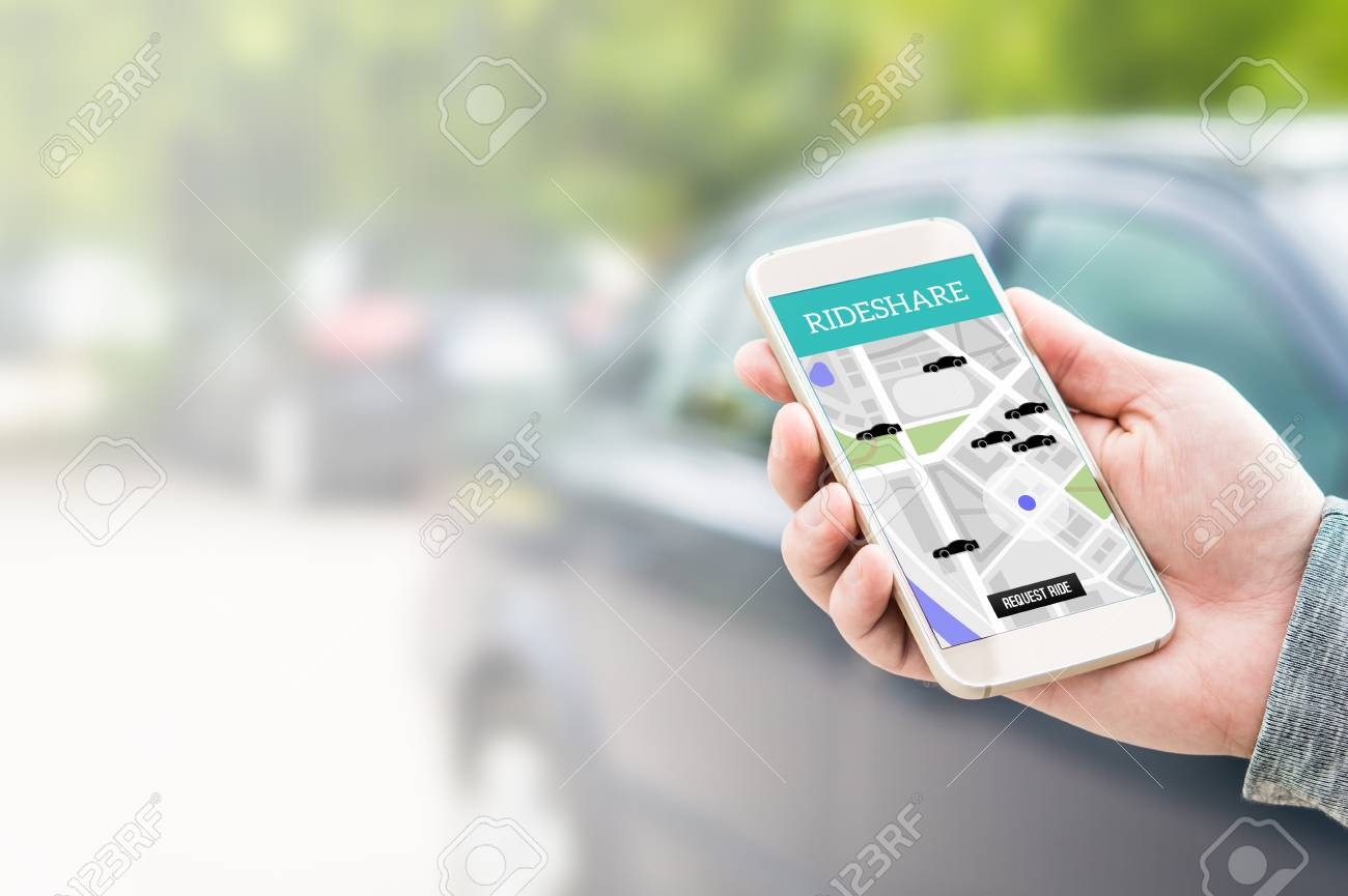 Rideshare taxi app on smartphone screen. Online ride sharing and carpool mobile application. Modern people and commuter transportation service. Man holding phone with a car in background. - 95505950