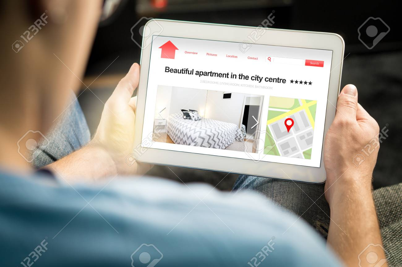 Man search apartments and houses online with mobile device. Holiday home rental or real estate website or application. Imaginary internet marketplace for vacation lodging or finding new home. - 95506058