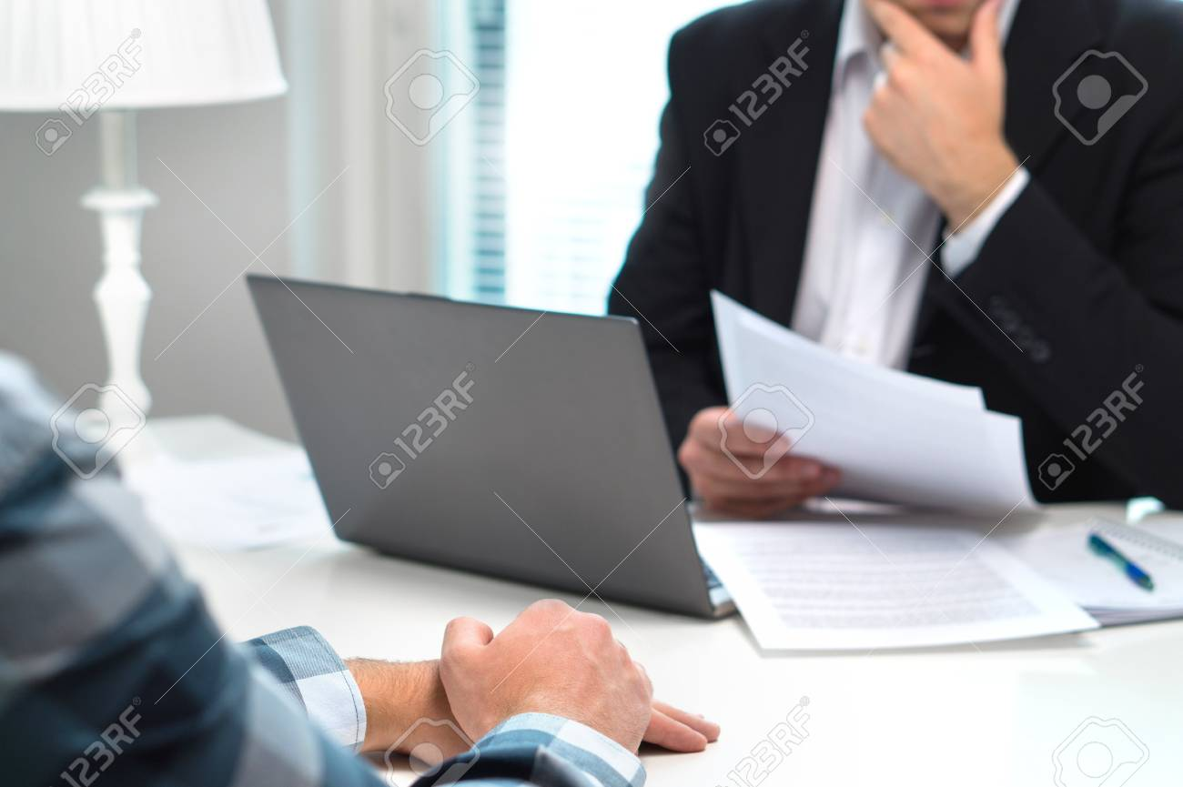 Job interview or meeting with bank worker in office. Business man considering. Discussion about loan, mortgage or insurance. Human resources conversation. Hiring or getting fired. Thoughtful man. - 95506080