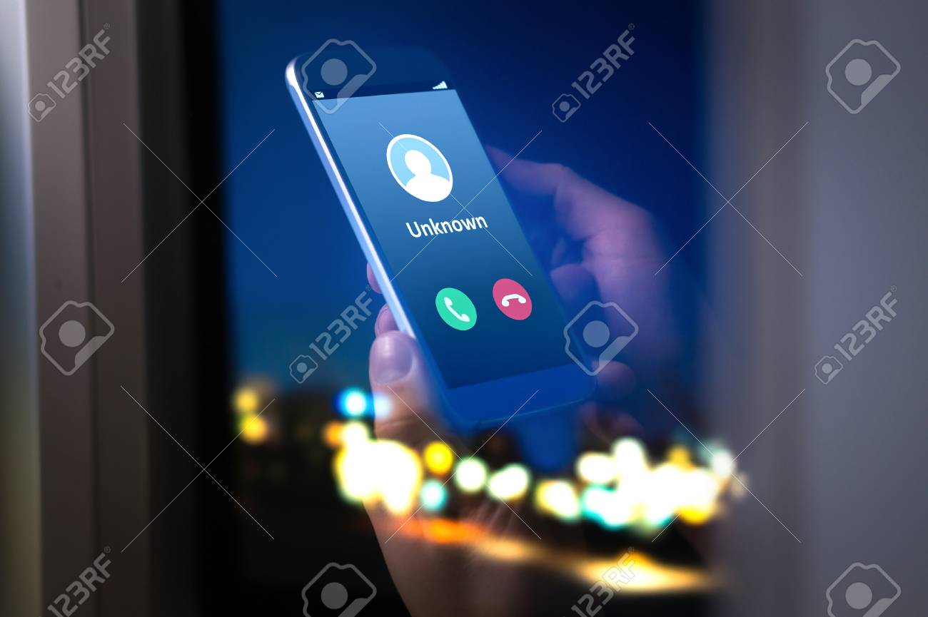 Unknown number calling in the middle of the night. Phone call from stranger. Person holding mobile and smartphone home late. - 95799965