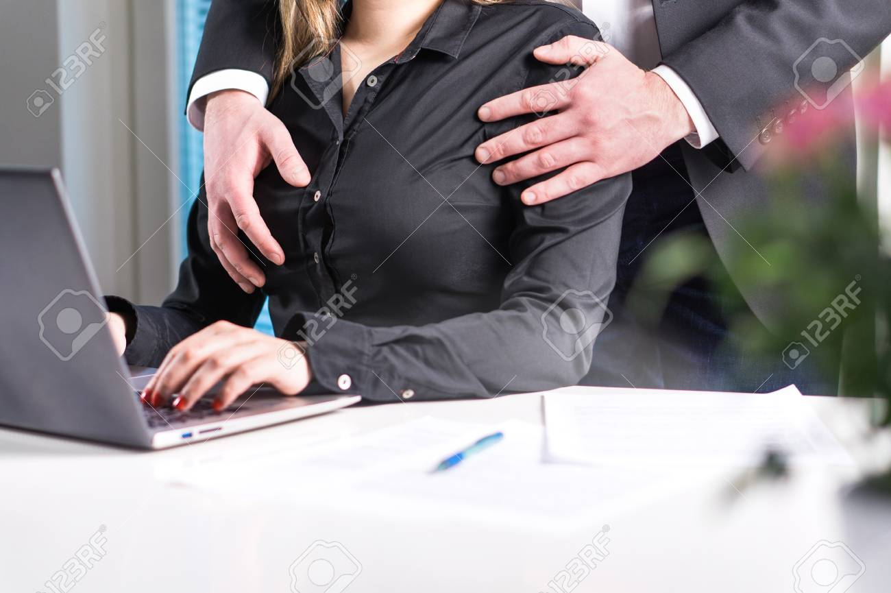 Ass Grope sexual harassment and abuse at work concept. man groping woman..