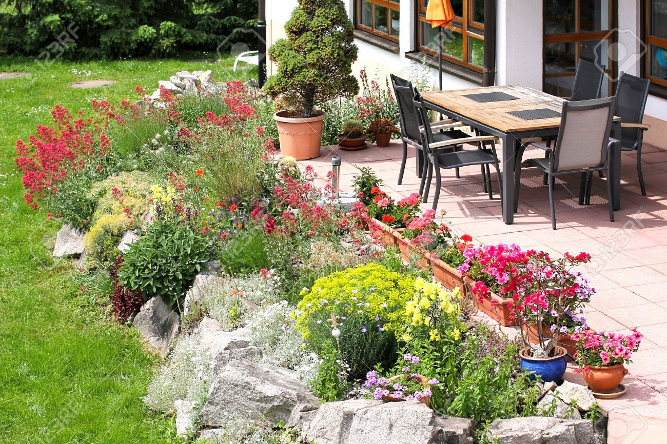 Terrace with garden furniture and rockery - 40866165