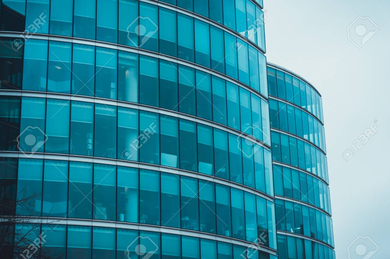 Exterior facades of two curved commercial buildings or office