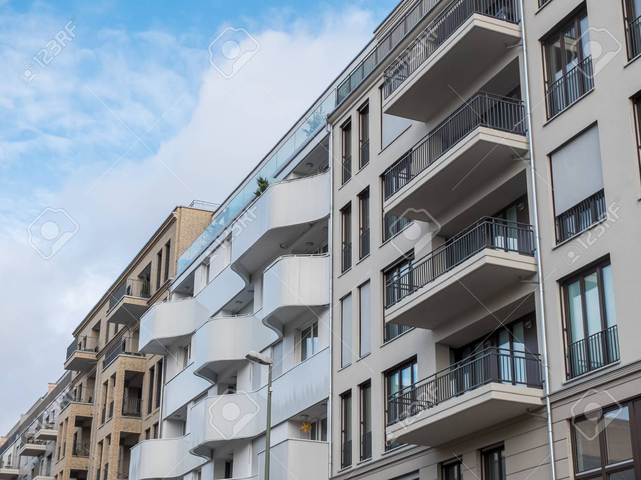 Low Angle View Of Modern Low Rise Apartment Building Facades With Balconies  In Residential Neighborhood With