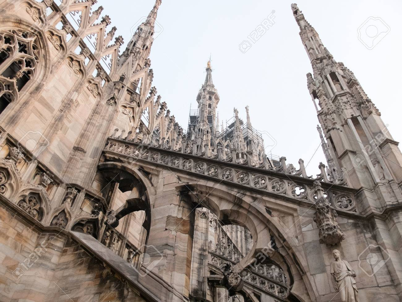 Low Angle Architectural Detail Of Italian Gothic Flying Buttresses And Spires Historic Milan Cathedral Church