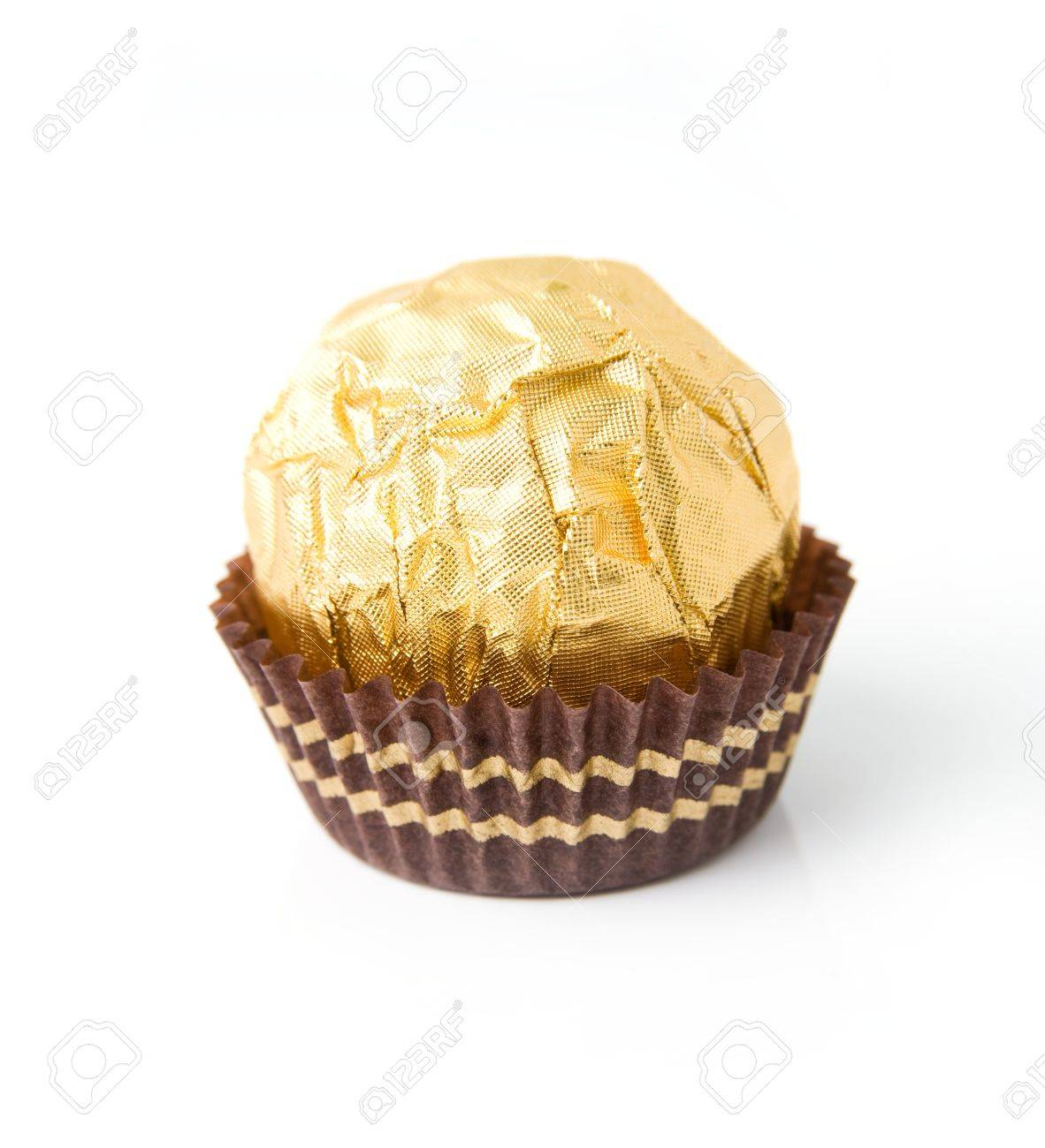 An Image Of A Sweet Candy In Golden Wrapper Stock Photo, Picture ...