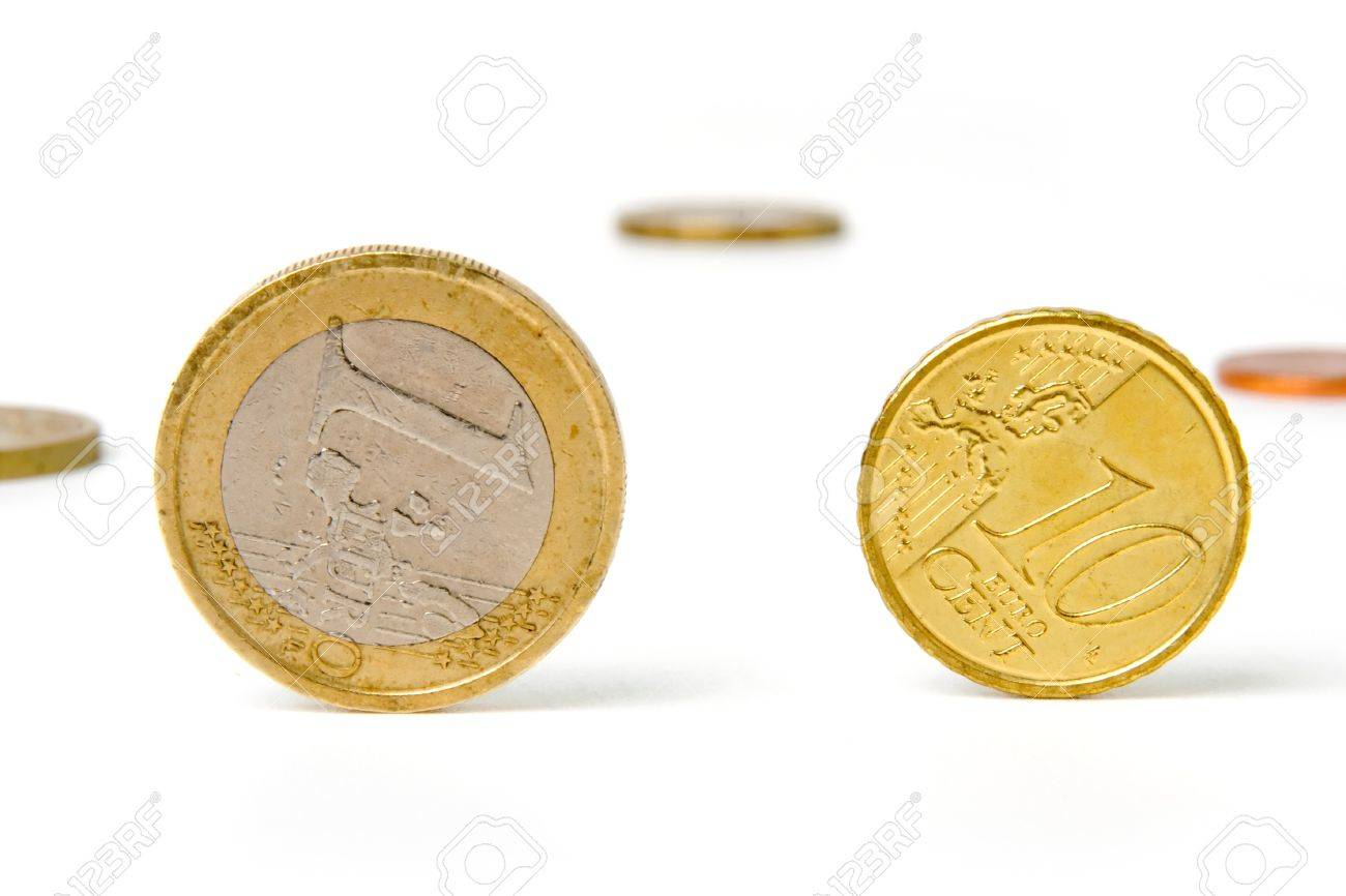 An image of shiny coins on white background Stock Photo - 17017441
