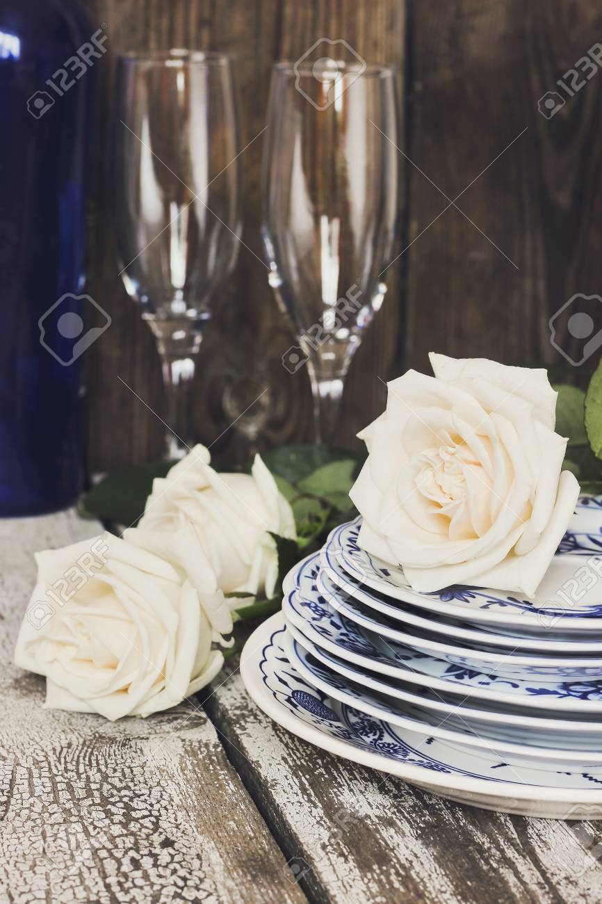 Clean Plates With White Roses Sparkling Wine Bottle Champagne