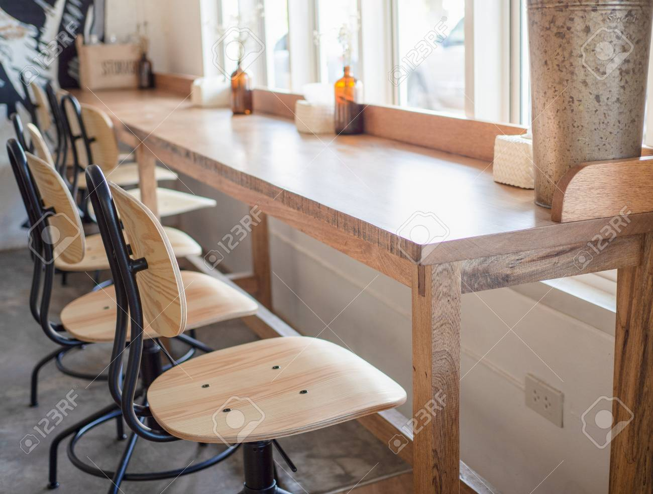 Modern Wooden Chais And Wooden Bar Table In White Butique Cafe Stock Photo Picture And Royalty Free Image Image 101864903