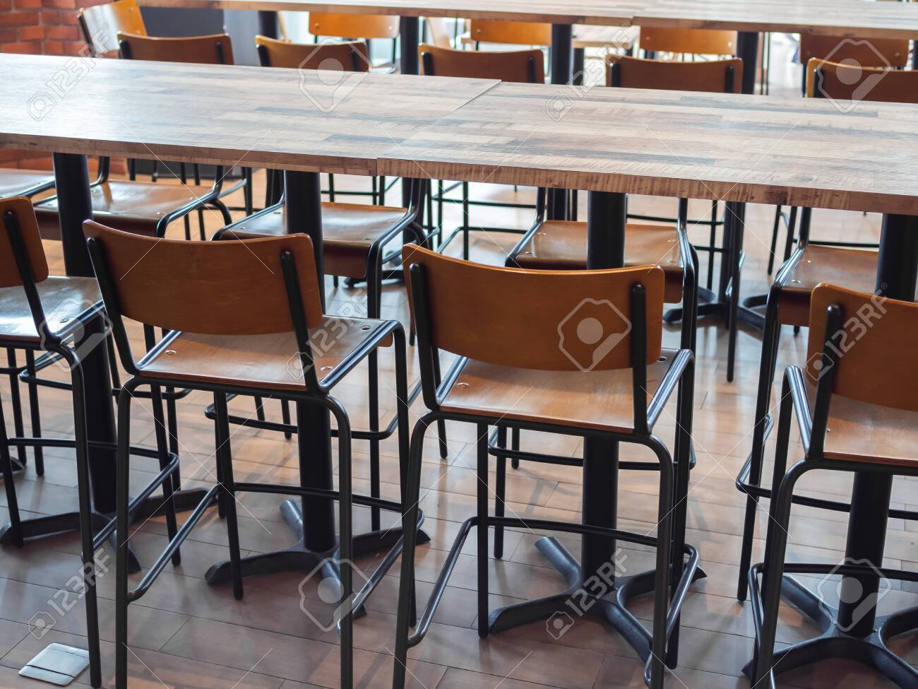 Row Of Retro Style Wooden Bar Stools And Modern Wooden Tables Stock Photo Picture And Royalty Free Image Image 119415747