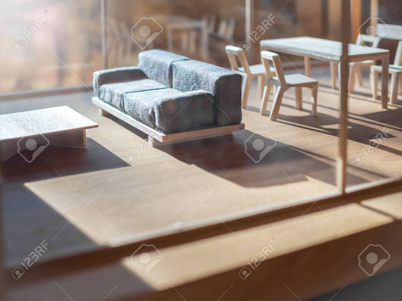 Sofa and wooden table set in living room balsa wood model. Miniature..