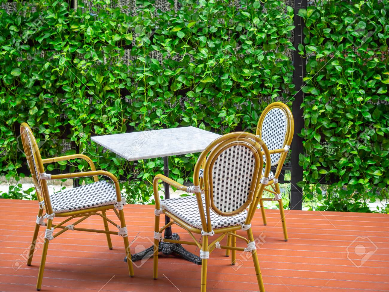 Three Wooden White Vintage Chairs With White Marble Table On Stock Photo Picture And Royalty Free Image Image 126767005