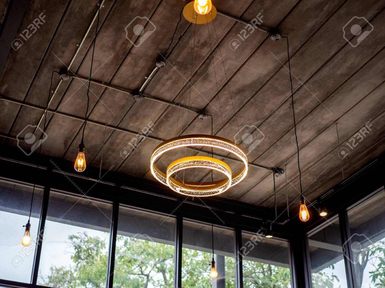 Modern Ceiling Light And Light Bulbs Hanging From Wooden Ceiling Stock Photo Picture And Royalty Free Image Image 126805079