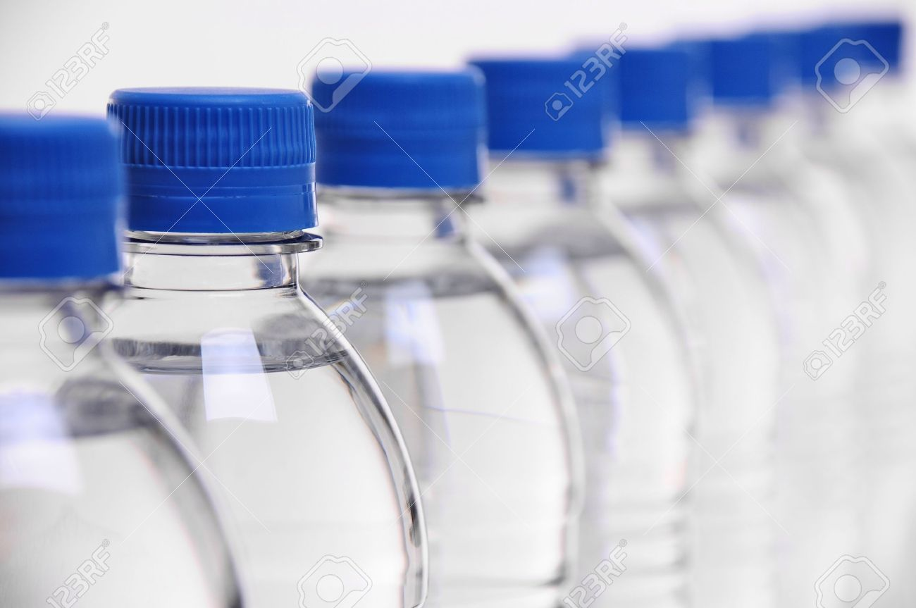 row of water bottle lids with select focus on second bottle Stock Photo - 14165150