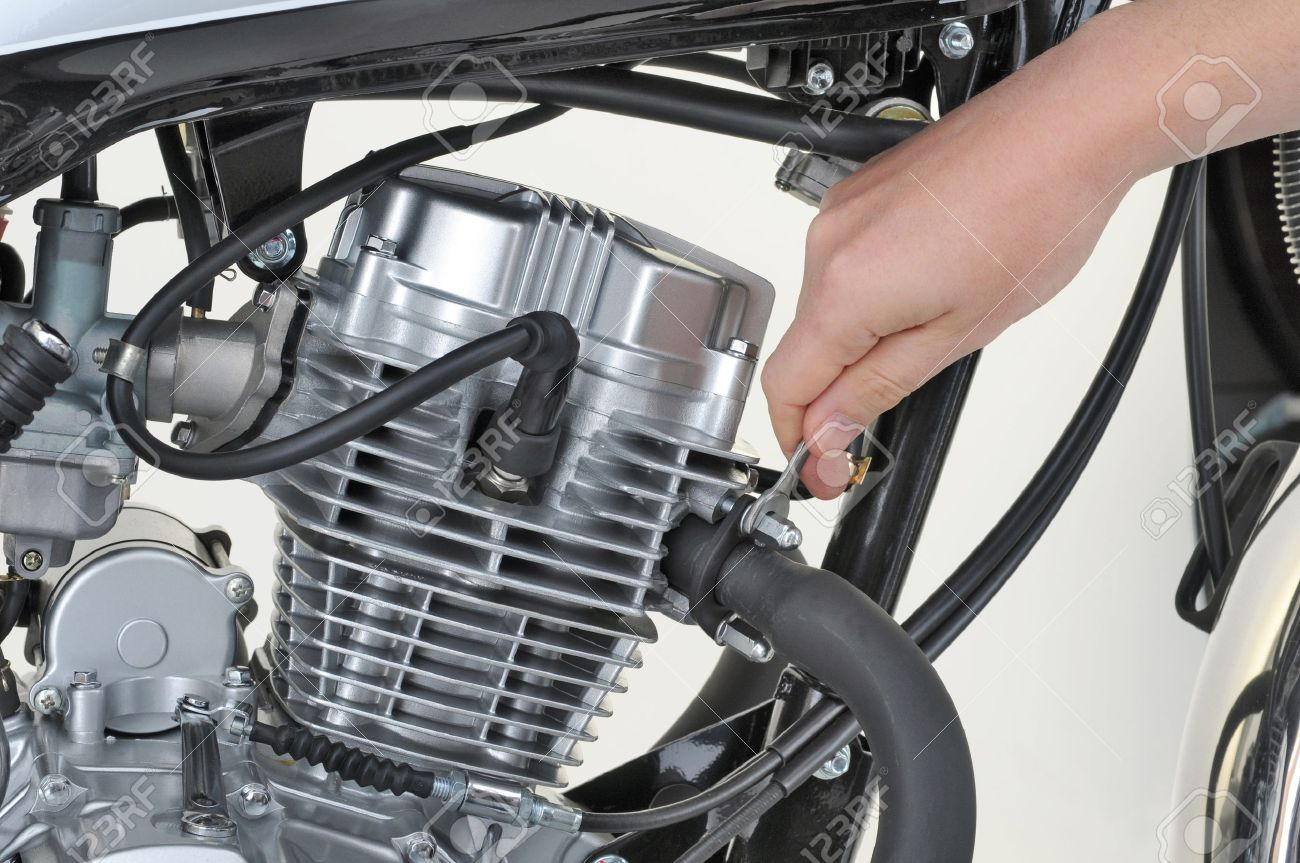 Mechanic Tightening The Exhaust On A Motorcycle Engine Stock Photo ...