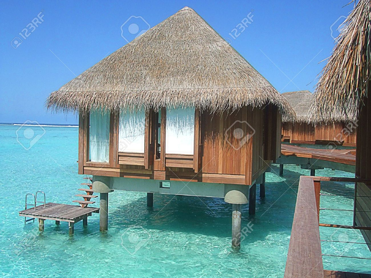 Over water Bungalow and the turquoise sea at the Maldives with beautiful blue sea and sky Stock Photo - 8300753
