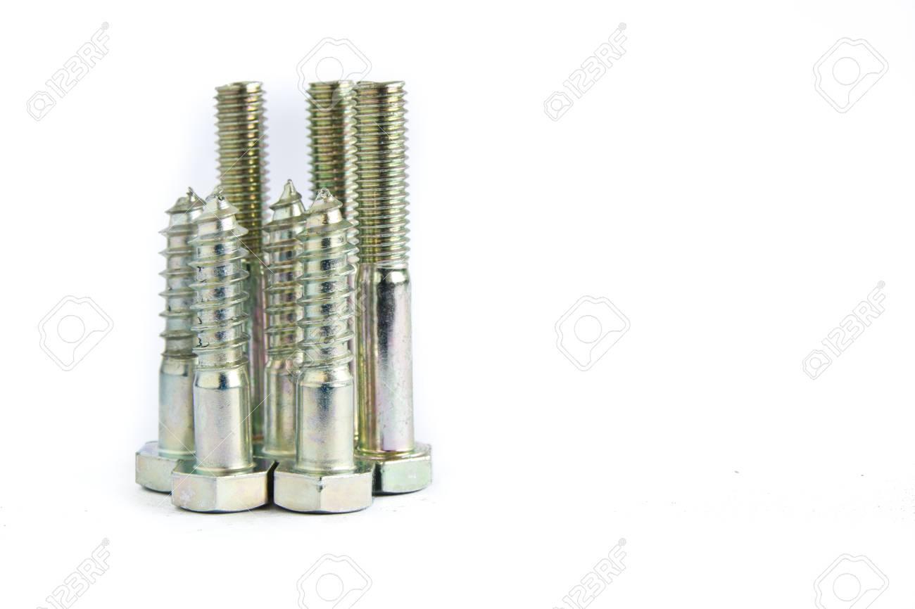 random pile of hexagonal threaded steel bolts or screws on white Stock Photo - 17581880