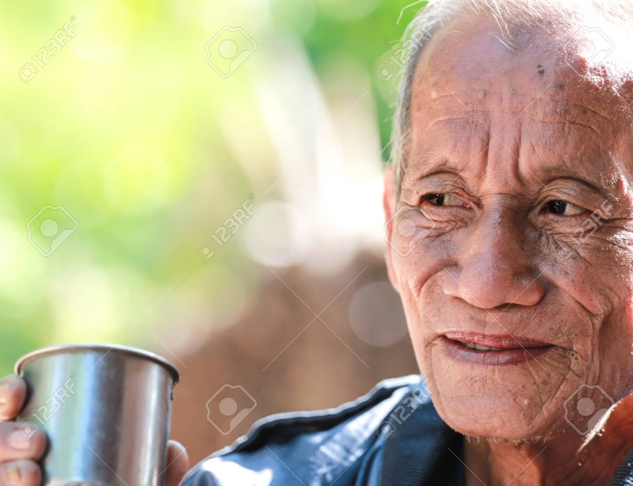 an aged cheerful old man holding a cup of coffee Stock Photo - 17533149
