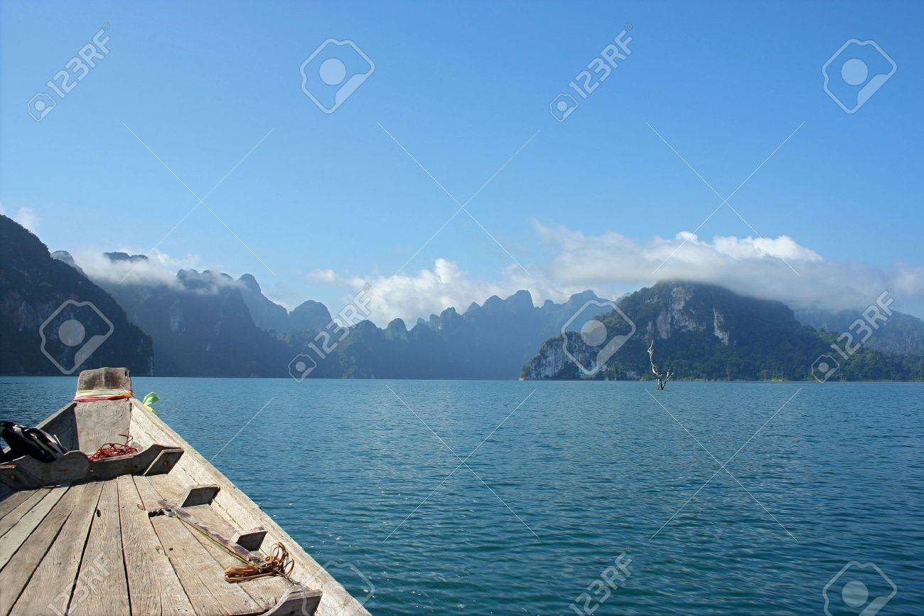 Turn the atmosphere within his chest Chiew Lan Dam. Surat Thani Province. When viewed from the long-tail boat while sailing away - 8055667