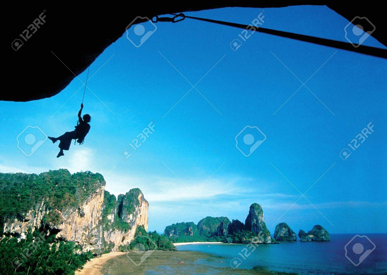 Silhouette of rock climbing in nature. Stock Photo - 8727771