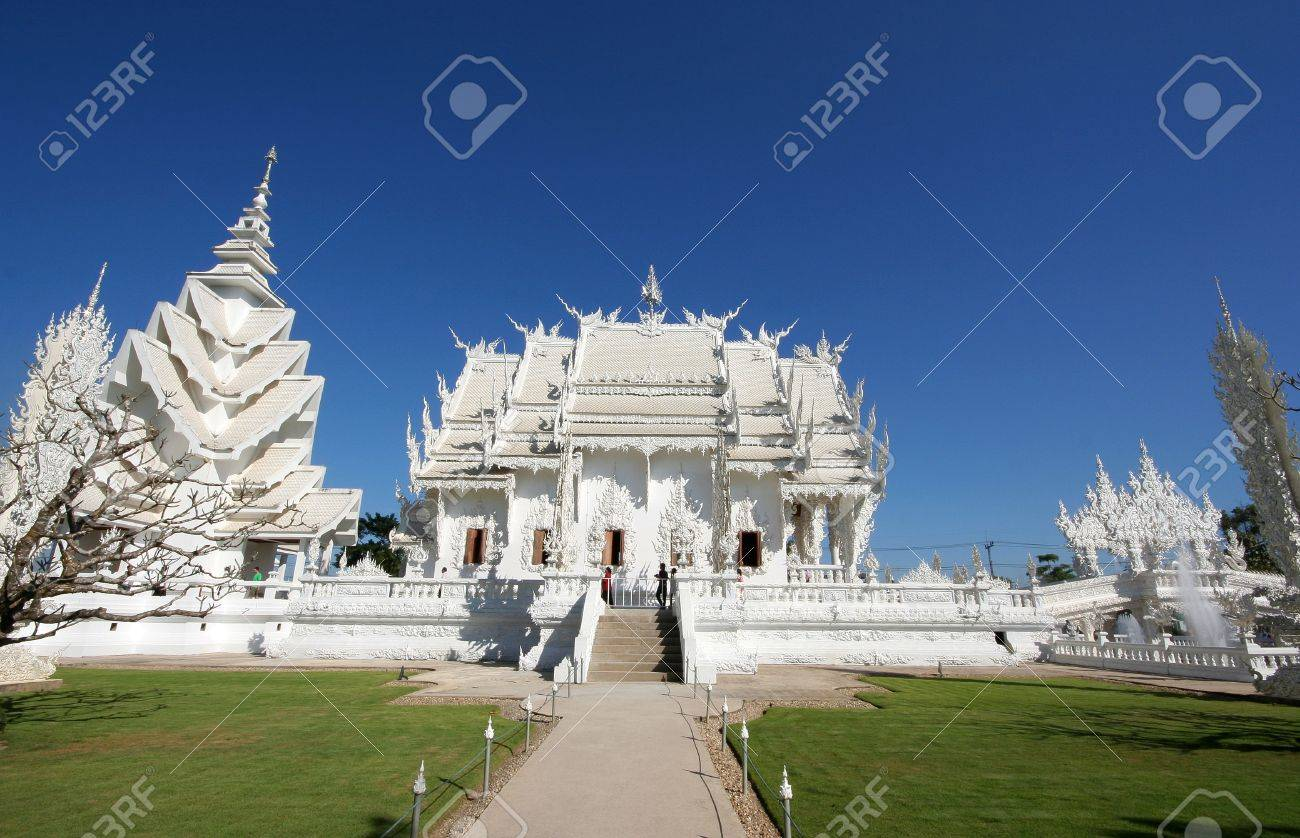 Wat Rong Khun in Chiang Rai,Thailand. Main chapel and pavilion of famous Wat Rong Khun (White temple) in Thailand - 9025998