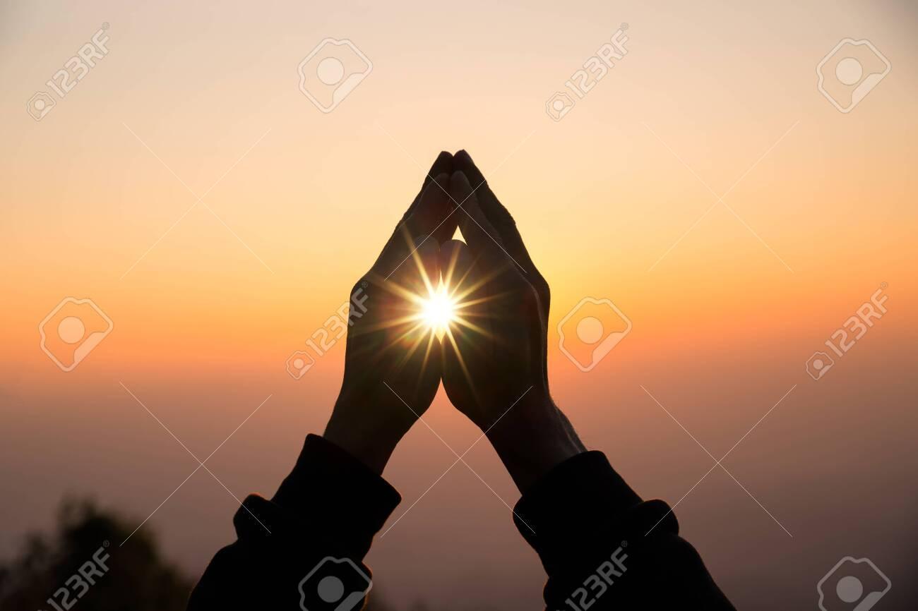 Silhouette of christian man hand praying, spirituality and religion, man praying to god. Christianity concept. - 139894020