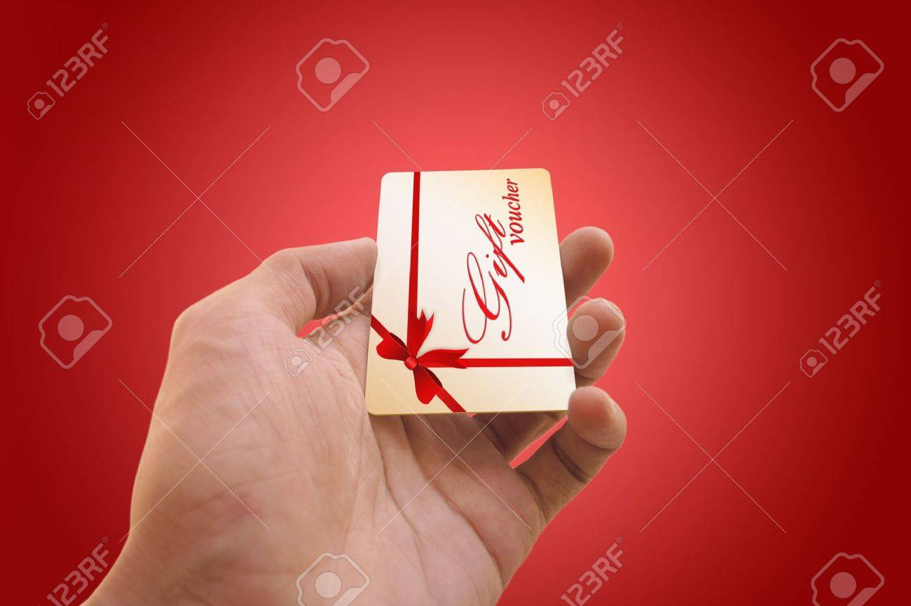 Man s hand holding a gift voucher card Stock Photo - 15559001
