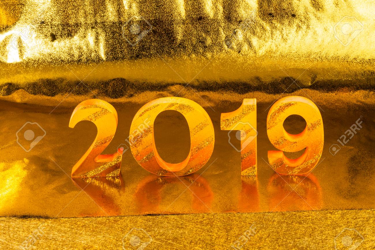 2019 is made in gold color place in golden background is mean