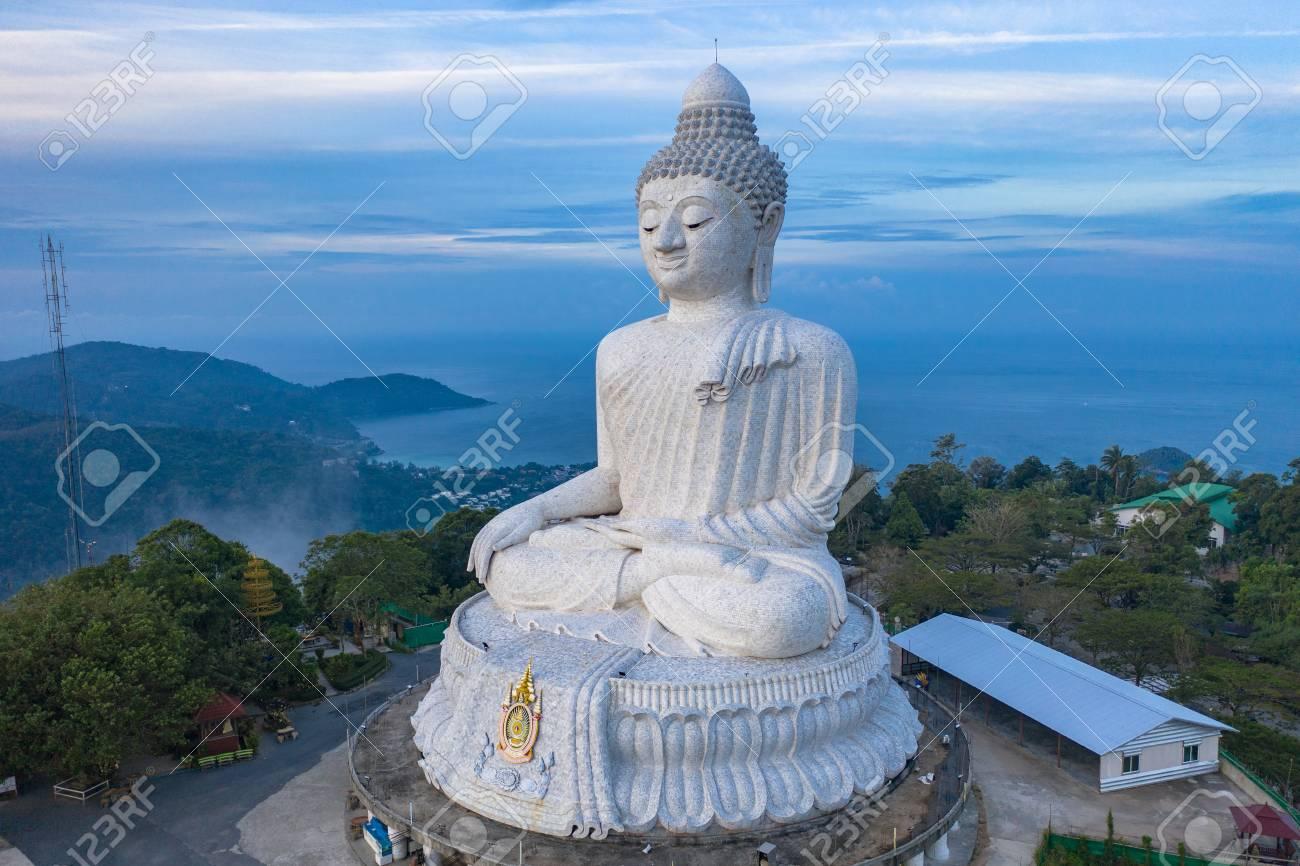 aerial photography scenery blue sky and blue ocean behind Phuket white big Buddha. Phuket white big Buddha is the famous landmark in Phuket island a lot of tourists visiting this landmark every day - 116614673