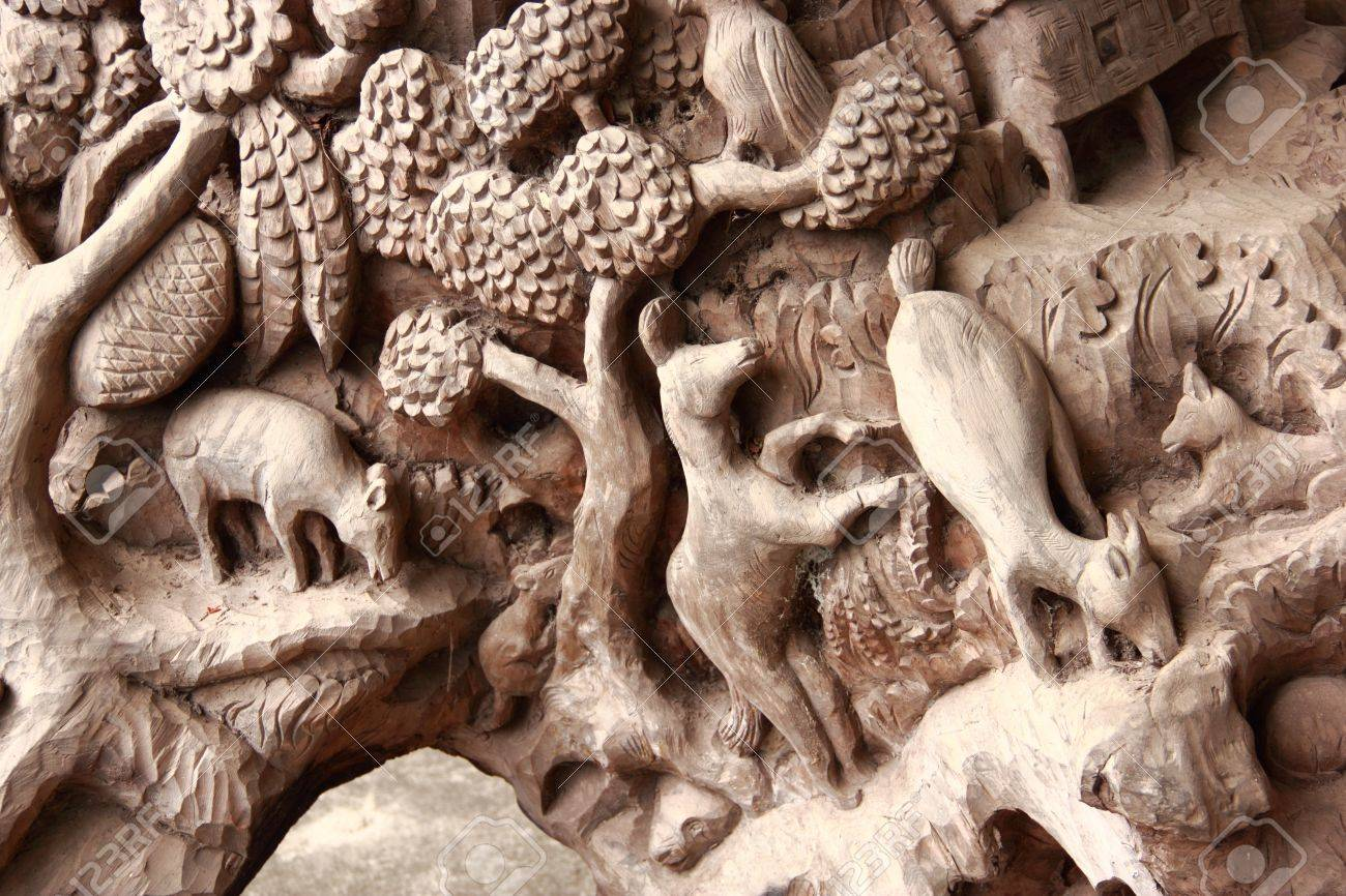 High relief carvings on the walls of the church in asia stock