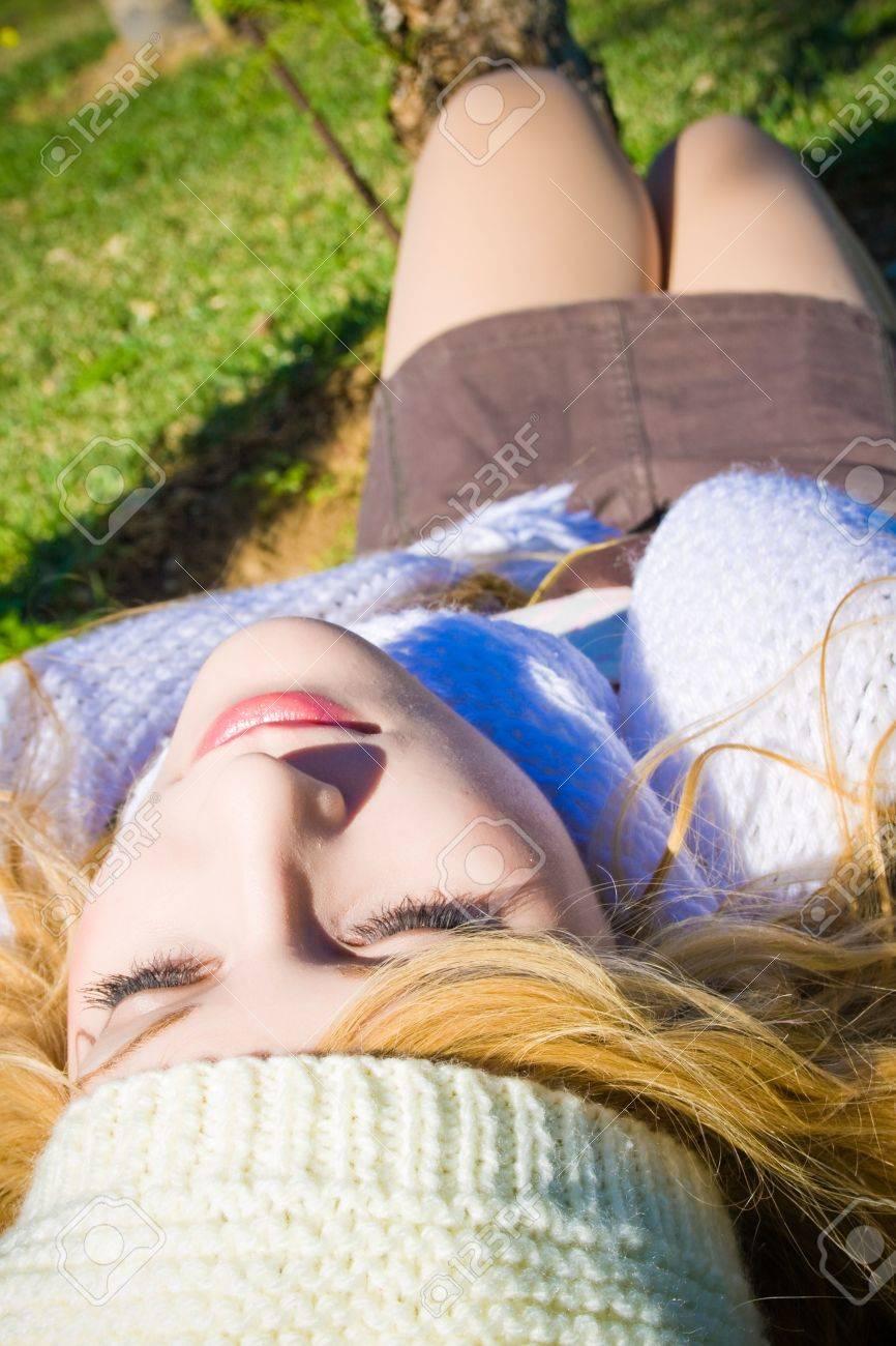 beautiful woman lying on the grass relaxing Stock Photo - 12024240