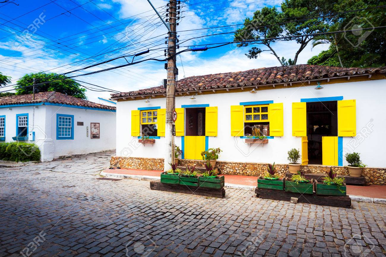 Small White Houses With Colorful Window Shutters In Buzios Brazil
