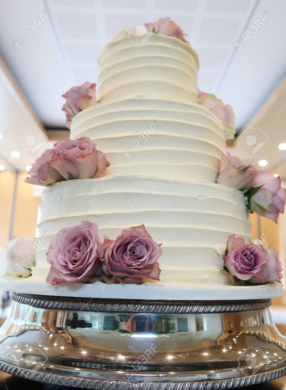 Amazing white wedding cake with pink flowers stock photo picture amazing white wedding cake with pink flowers stock photo 78894925 mightylinksfo
