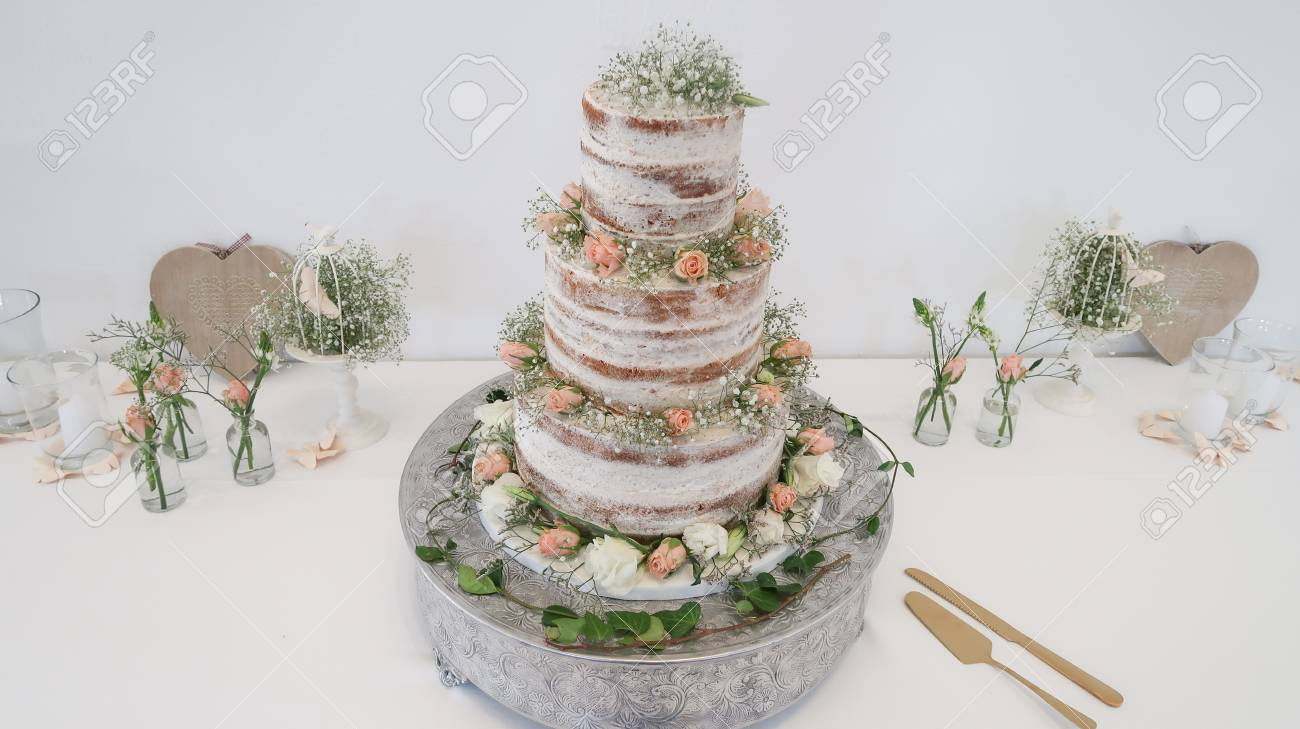 Amazing 3 Tier Wedding Cake With Flowers And Decor Stock Photo