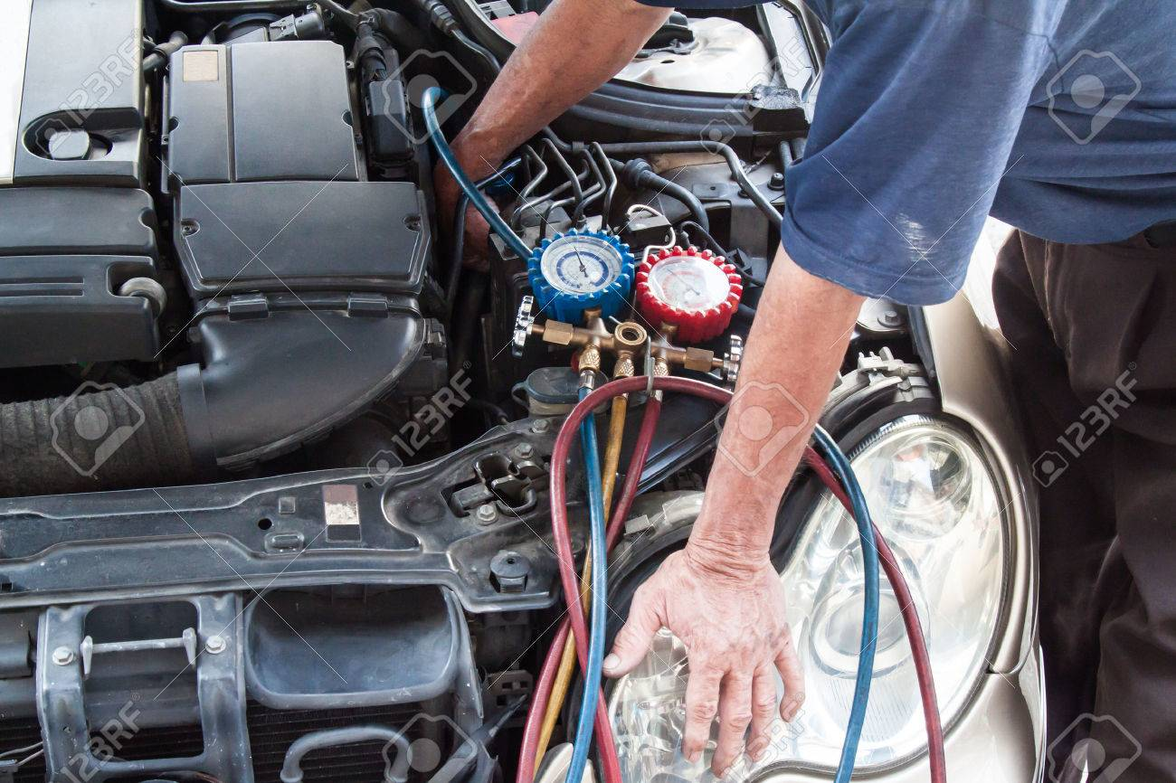 Mechanic With Manometer Inspecting Auto Vehicle Air-condition ...