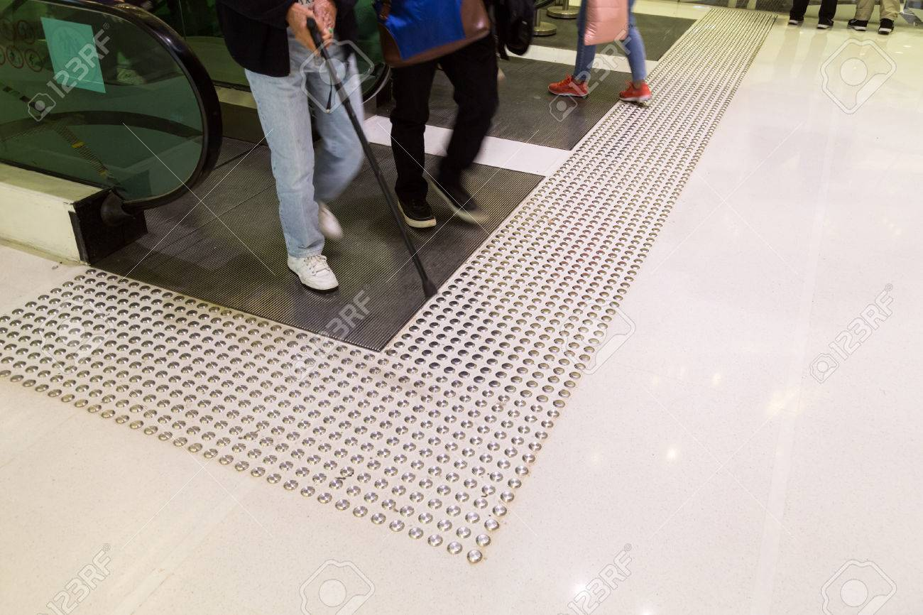 Tactile paving path for the blind and vision impaired handicap tactile paving path for the blind and vision impaired handicap entrance exit of escalator in hong dailygadgetfo Choice Image