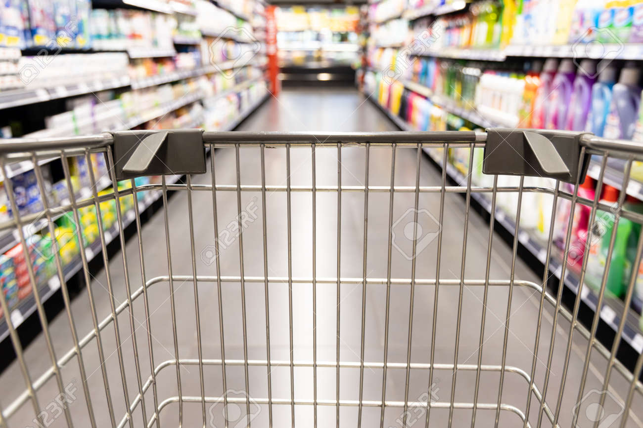 Shopping trolley cart moving in supermarket with motion blur aisle background - 168891211
