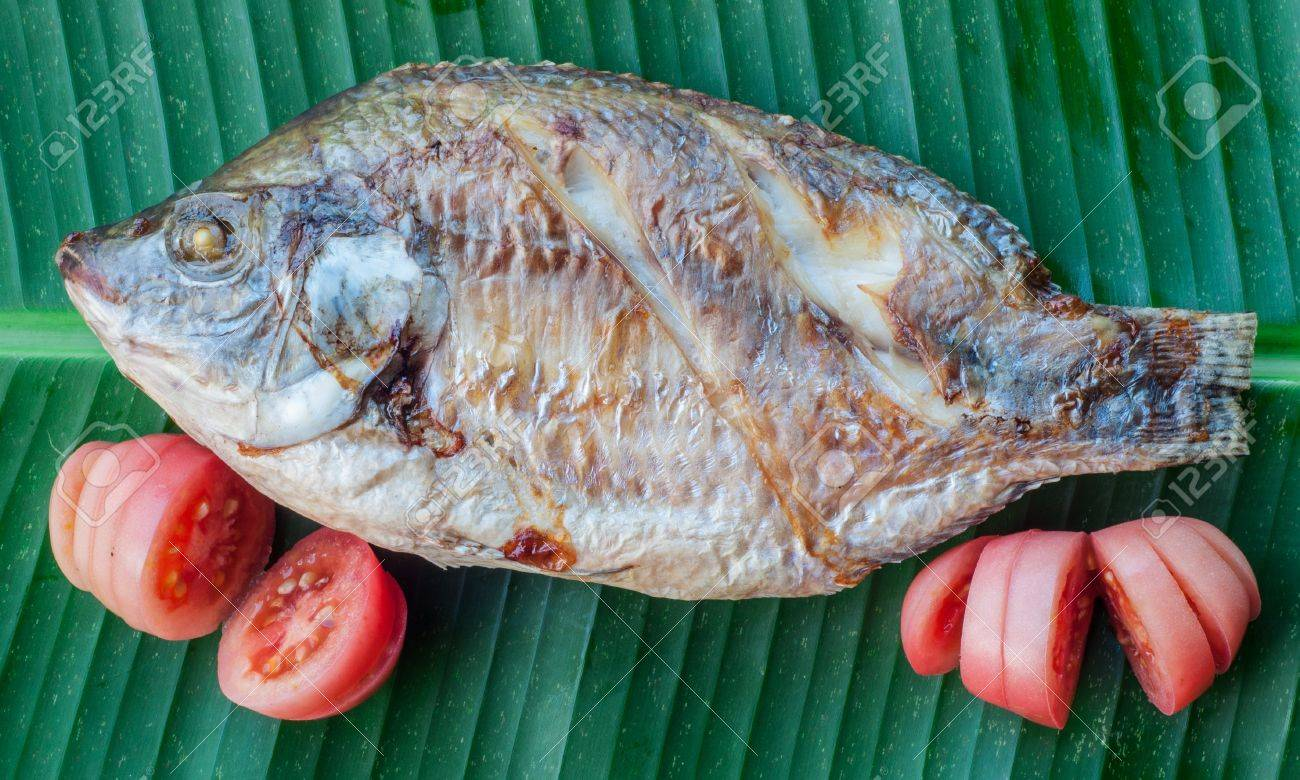Freshwater fish diet - Simple Grilled Freshwater Fish On Banana Leaf The Food Of The Villagers Stock Photo