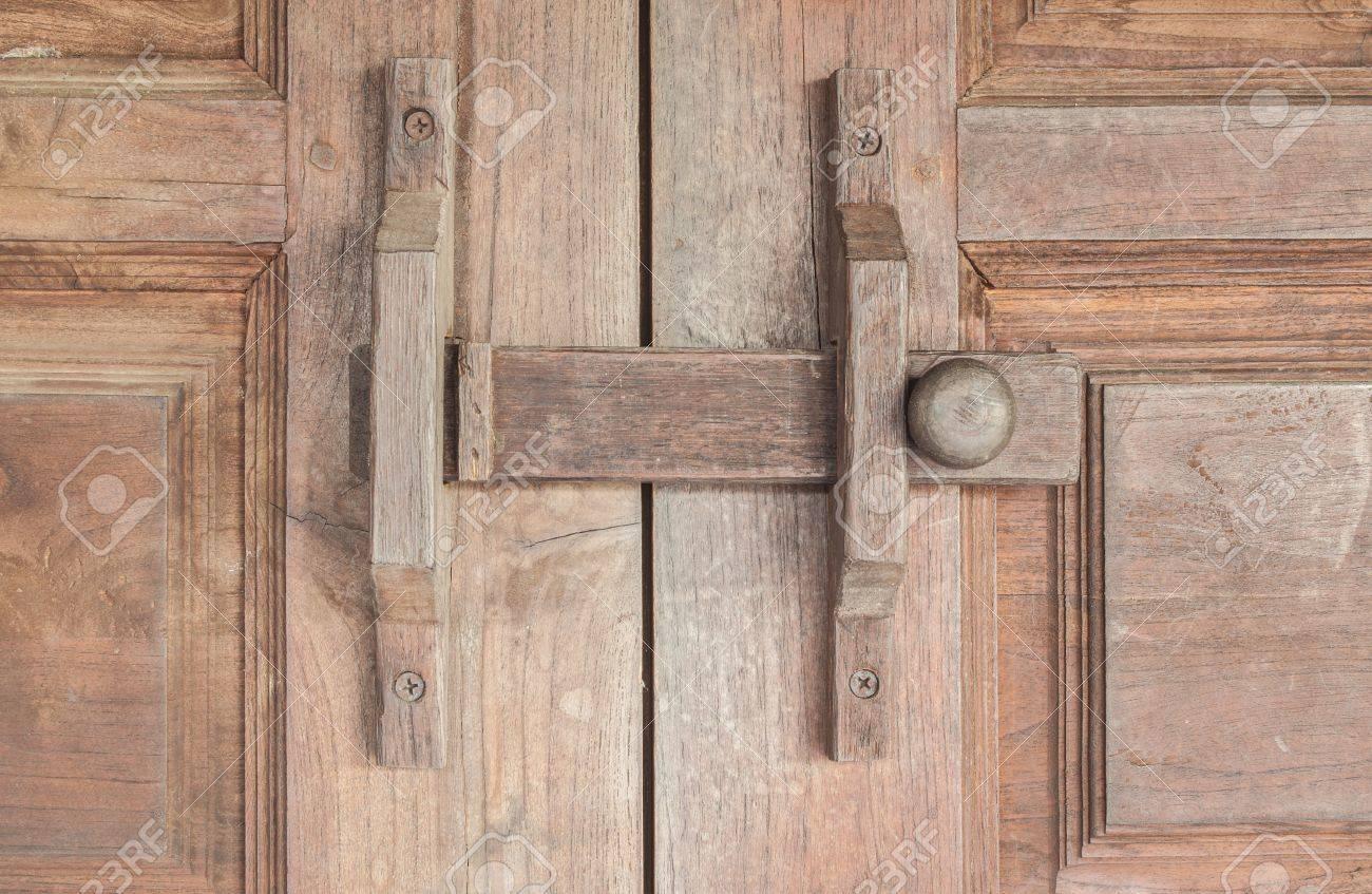 Wooden lock latch on wooden doors Stock Photo - 16527099