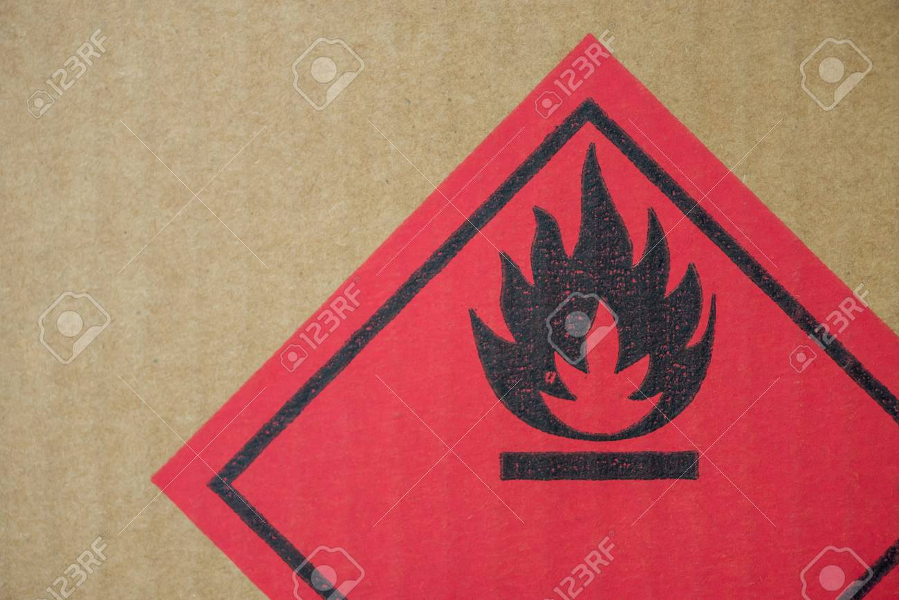 Close-up detail of a fire hazard warning symbol on a cardboard