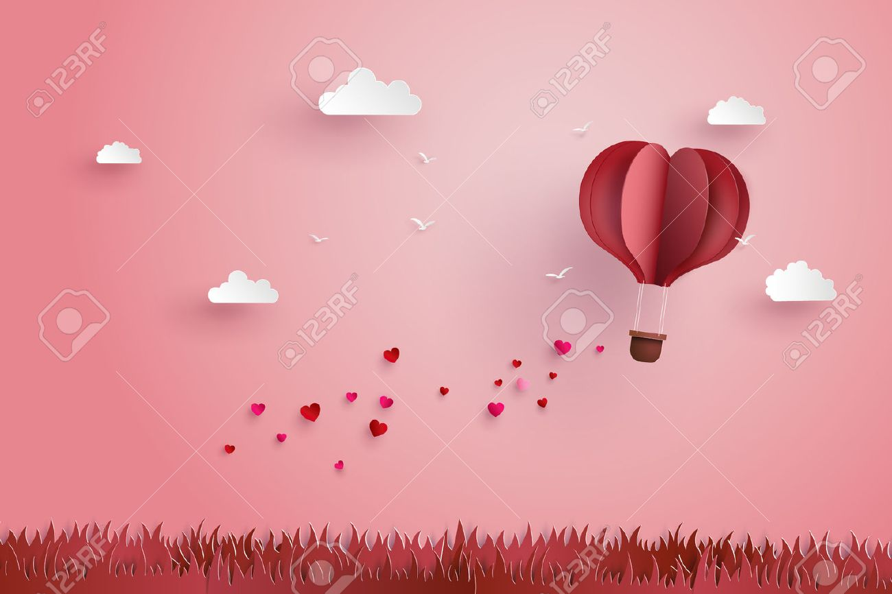 illustration of love and valentine day,Origami made hot air balloon fly over grass with heart float on the sky.paper art style. - 69261610