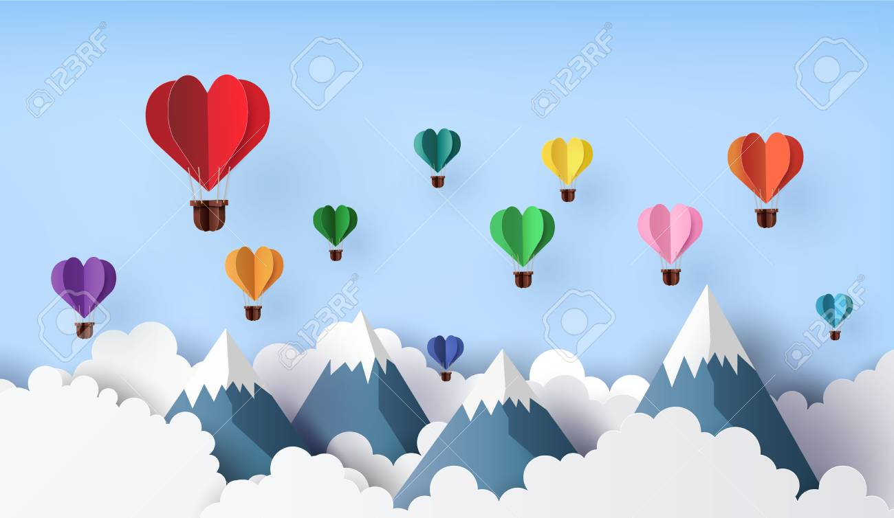 Origami made hot air balloon in a heart shape float over the mountain. paper art 3d from digital craft. - 119957127