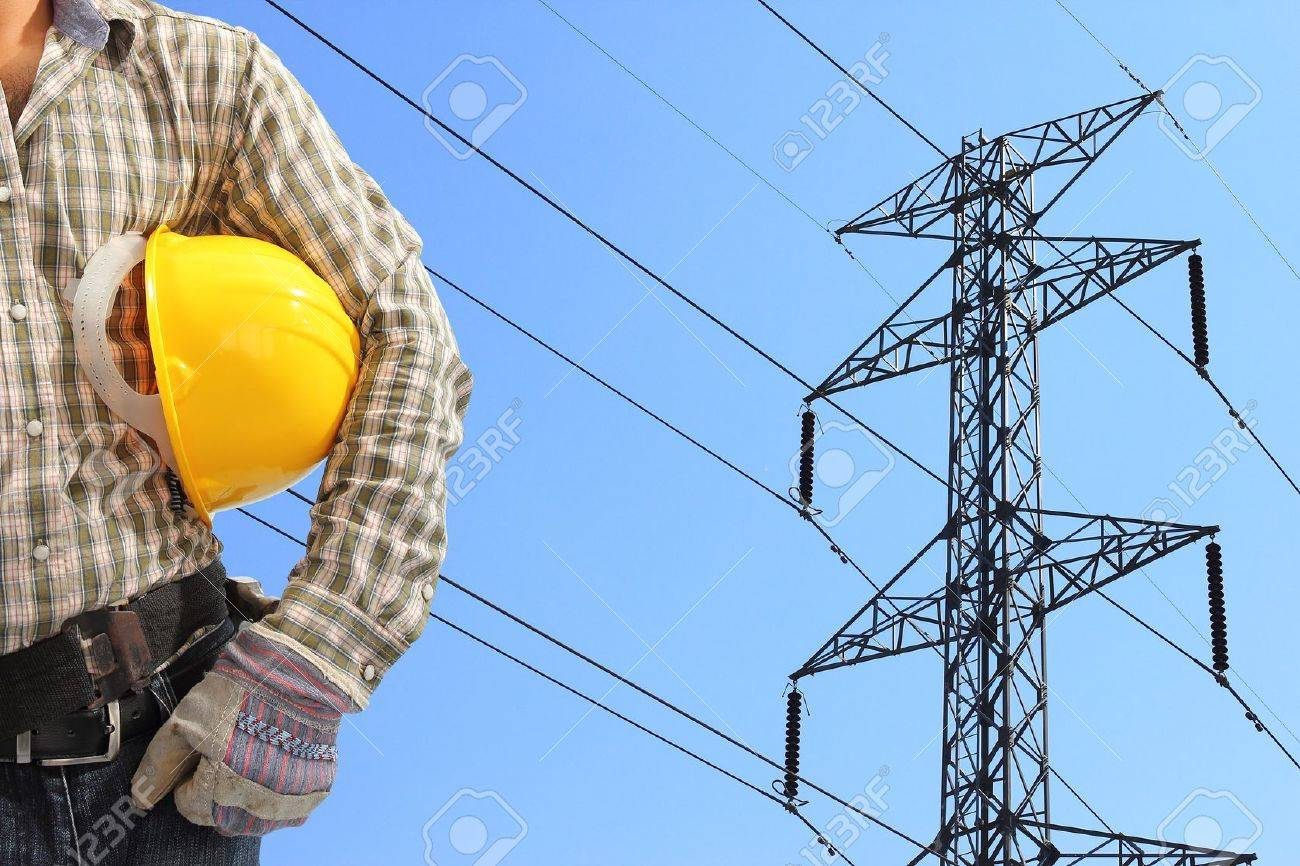 Attractive Electrician And High Voltage Power Pylon Against Blue Sky Stock Photo    17213075 Nice Look
