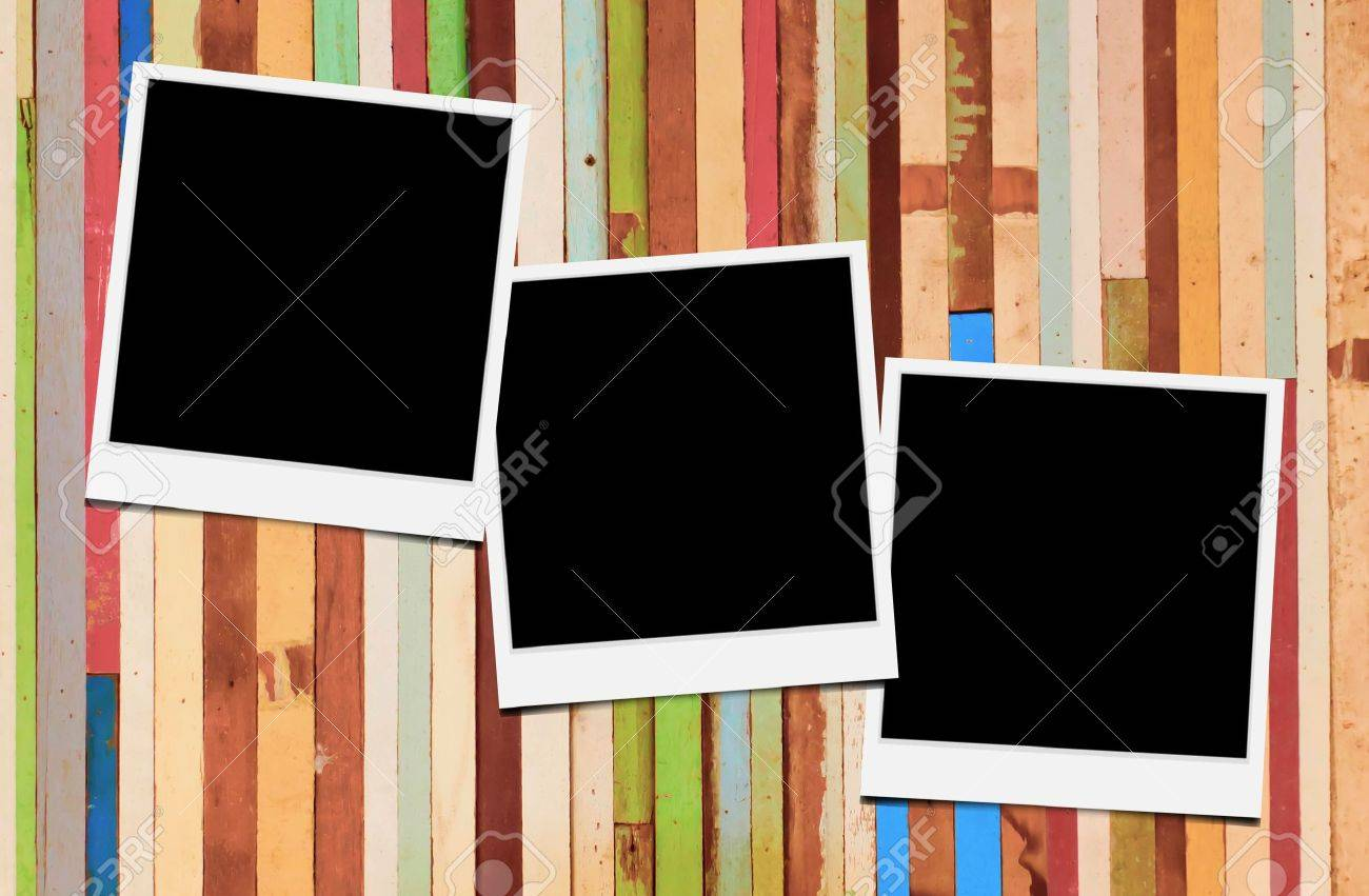 blank instant photo frames on wooden background stock photo 14453473