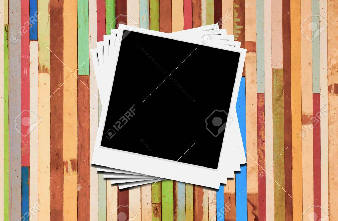 Blank instant photo frames on wooden background. Stock Photo - 14453450