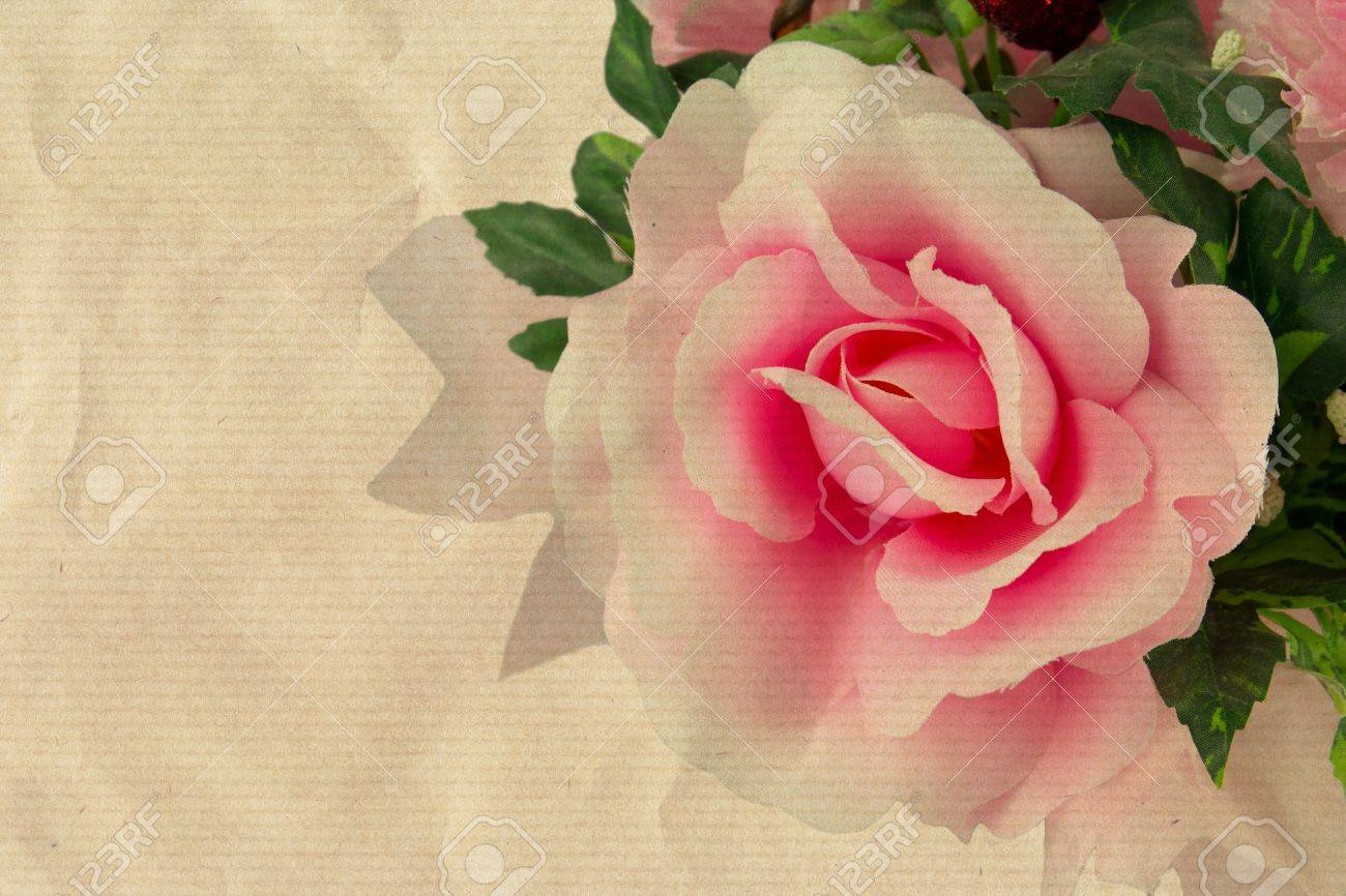 Pink Fake Flowers On An Old Paper Stock Photo Picture And Royalty